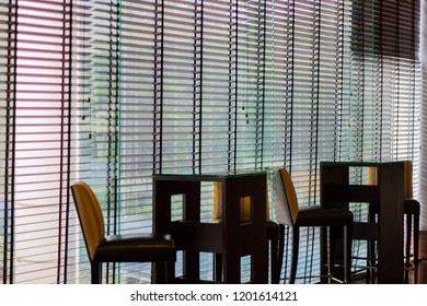 Long blind,jalousie,curtain, Louvers , shade, sunblind, roller, shutter protected sunlight background and glass room.