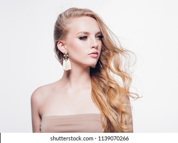 Long blonde hair beautiful woman with lashes beauty and curly blond hairstyle isolated on white
