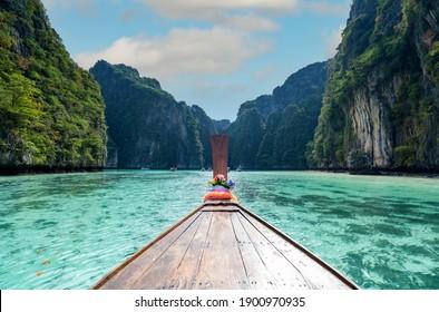 Long boat and blue water at Pileh Lagoon in Ko Phi Phi Lee Thailand