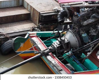 a long boat with a small motor driving a propeller at the end of a long shaft