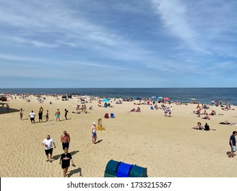 LONG BRANCH, NEW JERSEY - MAY 16, 2020 - N.J. state parks reopen on Saturday and people flock to crowded beaches as want to be outside and not cooped up due to Covid-19 Coronavirus