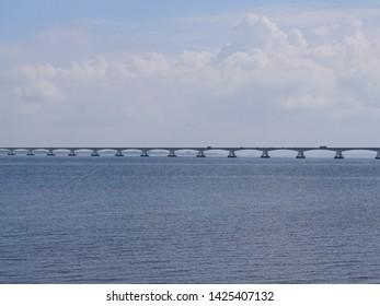 long bridge in the rivers Rhine, Maas delta in the Netherlands, called Zeelandbrug, near the small town Colijnsplaat on the island Beveland at the estuary Oosterschelde
