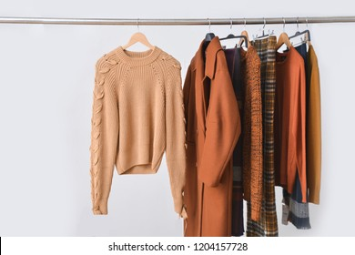 long brown coat, jacket, stripy shirt ,sweater clothes , stripy scarf on Hangers