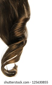 Long brown curl isolated