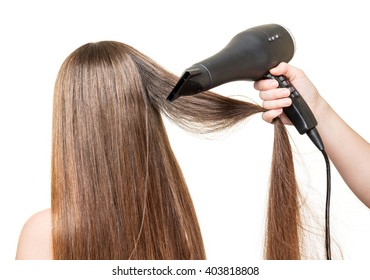 Long brown hair, and hair dryer in a hand isolated on white background.