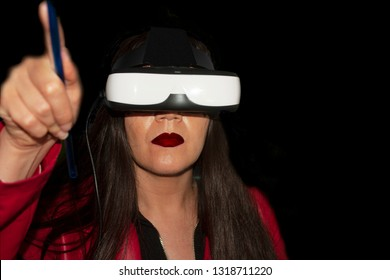 Long brown hair woman with red jacket living augmented reality experience with special lenses to observe augmented reality