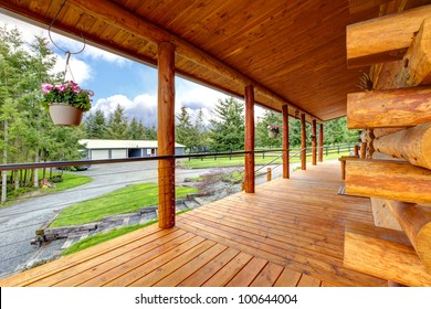 Long cabin horse farm house porch with view on the horse shed.