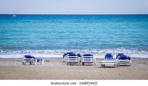 Long chairs on the beach of Albir