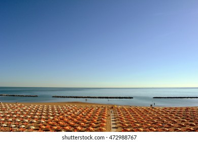 Long chairs on the beach in Rimini.