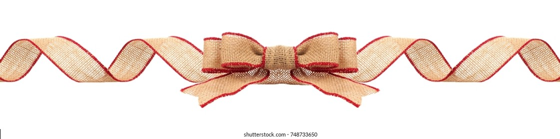 Long Christmas border with burlap bow and ribbon with red trim isolated on a white background
