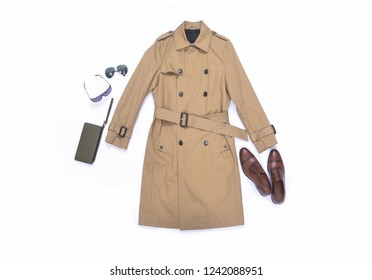 Long coat with leather shoes,sunglasses, ,purse on white background