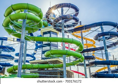 Long colorful water slides in aquapark at summer