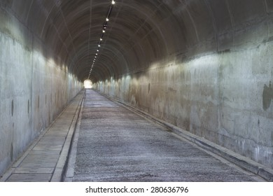 A long concrete tunnel leads down underneath a dam wall in South Africa.