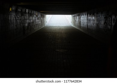 A long concrete tunnel, underground pedestrian crossing in the city. Underpass.