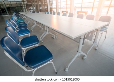Long Conference table and chairs . Before conference in the boardroom office interior .