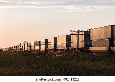 Long Container Train at Sunrise on Canadian Prairie