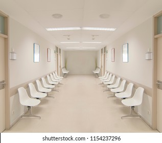 long corridor in hospital with doors and reflections