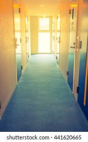 long corridor of hotel room  ( Filtered image processed vintage effect. )