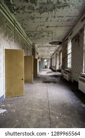 Long corridor and isolation cells at an abandoned and derelict lunatic asylum/hospital, Cane Hill, Coulsdon, Surrey, England, UK