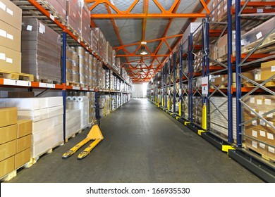 Long corridor with shelving system in distribution warehouse