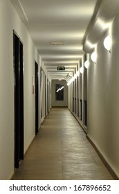 The long corridor with a succession of wall lamps, in its own electrical lighting