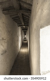 Long corridor in a long wall in Italy