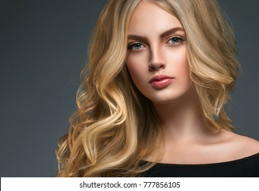 Long curly hair blonde woman skin care beautiful portrait. Beauty hairstyle female young model