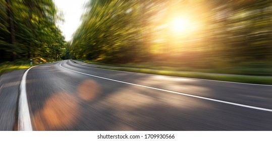 Long Curvy Forest Road In Alpine Mountains with motion blur, Backplate or Backdrop background.