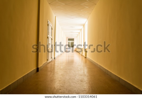long dark corridor with bright light from windows, light at the end of corridor, abstract background