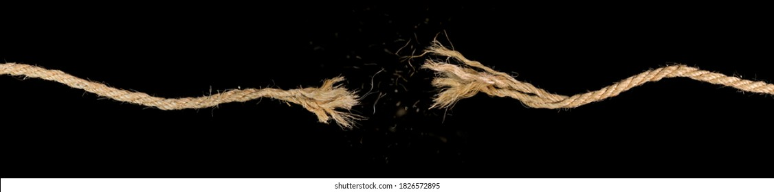 Long dirty rope, frayed at both ends and snapped in two. Concept of dangerous stress or stressful situation like divorce separation, deadlines, failure, or tension.