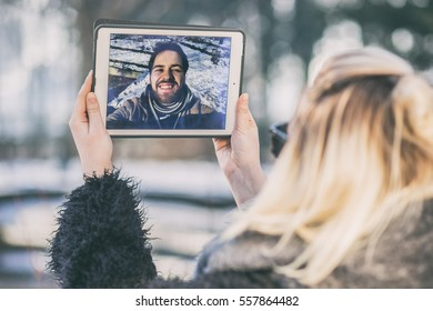 long distance relationship. young couple in love chatting over a video call, by using a tablet.