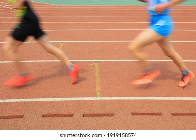 Long distance runners are running on the track
