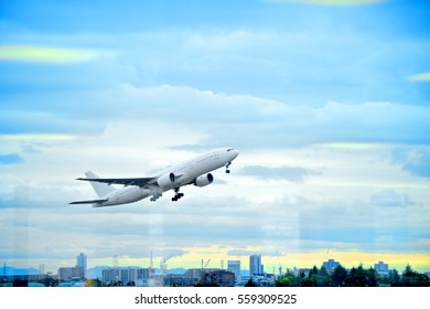 Long distance travel with modern airplane safe to travel flying above clouds in a blue sky.