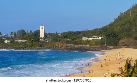 a long distance view of the beach a waimea bay on the north shore of hawaii