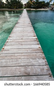Long dock at resort in pretty, clear, tropical waters of Caribbean Sea