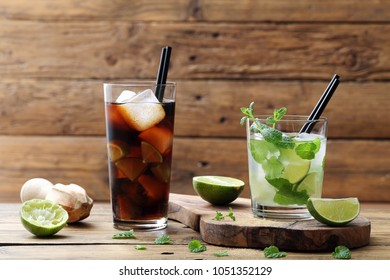 long drink with lime mint leafe and cola rustic background