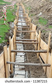 Long earth excavation protected on two sides by wooden shuttering