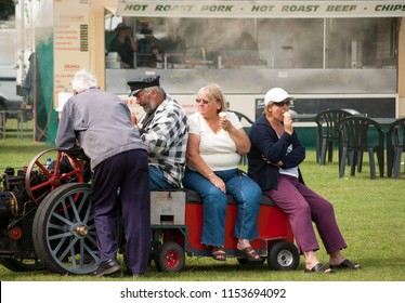 Long Eaton, Derbyshire, UK, 07/21/2014 Small vintage traction engine overloaded with fat people