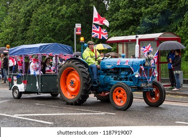 Long Eaton, Derbyshire, UK 07/21/2014 Vintage tractor towing a trailer full of people
