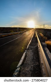 Long Empty Desert Asphalt Road in the Canary Islands Spain