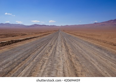 A long and empty road in the desert in northern Chile