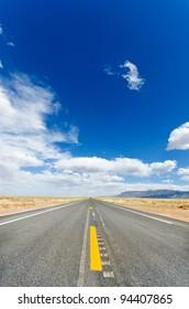 Long empty road running to the far horizon