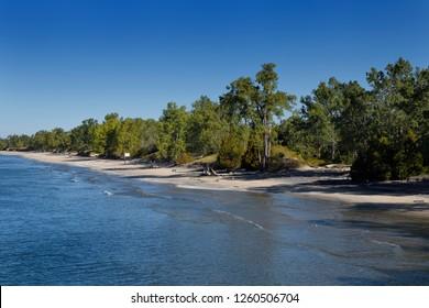 Long empty Sandbanks beach in Sandbanks Provincial Park on Lake Ontario, Prince Edward County Canada