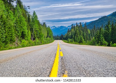 Long endles yellow line road in beautiful Canada. The trees form a wonderful canvas.