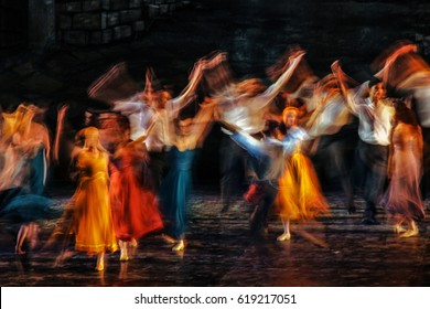 Long exposed and colorful photo of the dancers performing their art in a musical.