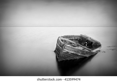 Long exposure of a abandoned boat in black and white