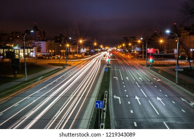 Long Exposure abstract urban background - Speed Traffic at Sundown Time - light trails on motorway highway at night, fantastic sky