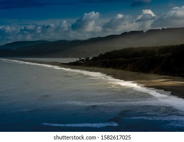 Long exposure Agate Beach in Patrick's point state park, from above, in Northern California, USA, l featuring predominantly blue colors and some clouds