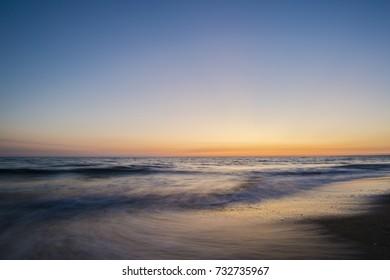 Long exposure. Beautiful sunset over the mediterranean sea. Sabaudia, Italy.