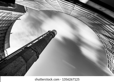 Long exposure black and white image of the historical Jameson Distillery chimney framed by its surrounding buildings